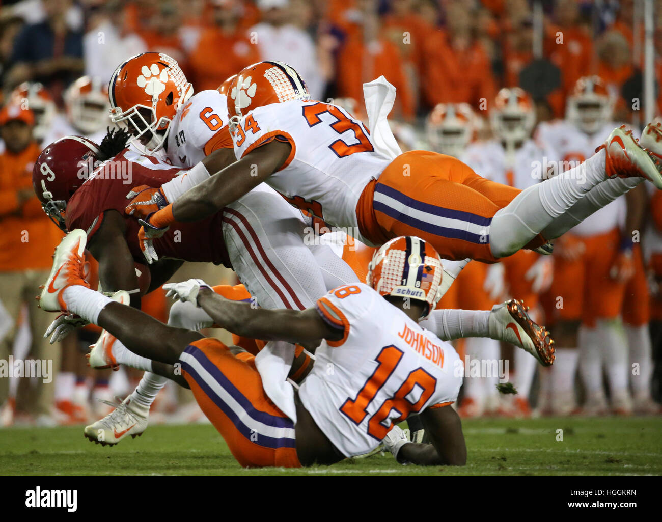 Tampa, USA. 9th Jan, 2017.Alabama Crimson Tide running back Bo Scarbrough (9) is stopped by Clemson Tigers during Stock Photo