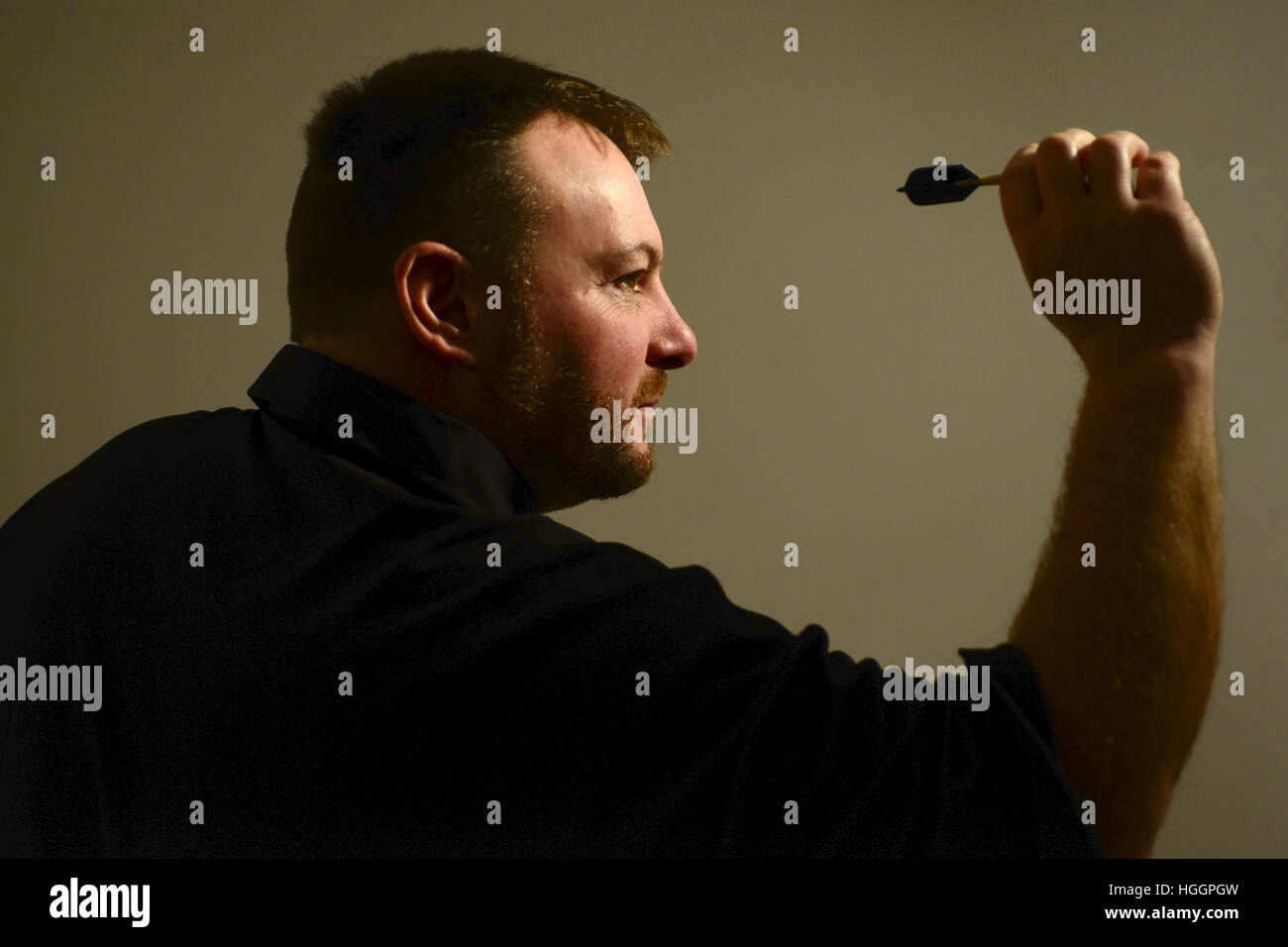Darts player Brian 'Doggy' Dawson at his home in Thurnscoe near Barnsley, South Yorkshire, UK. - Stock Image
