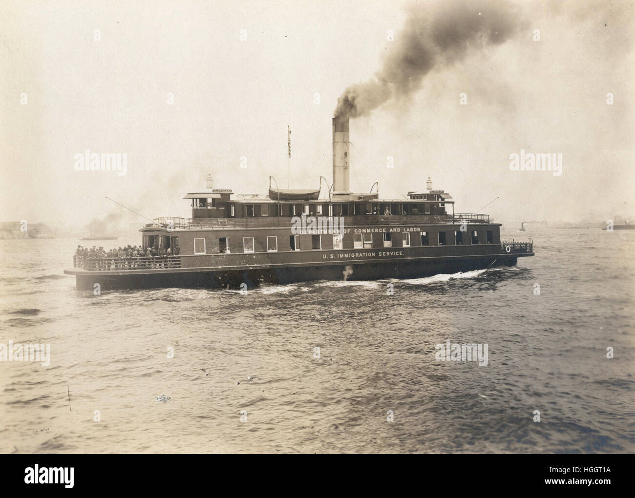 Ferry boat, the Ellis Island, which is also marked Department of Commerce and Labor, U.S. Immigration Service.  - Stock Image