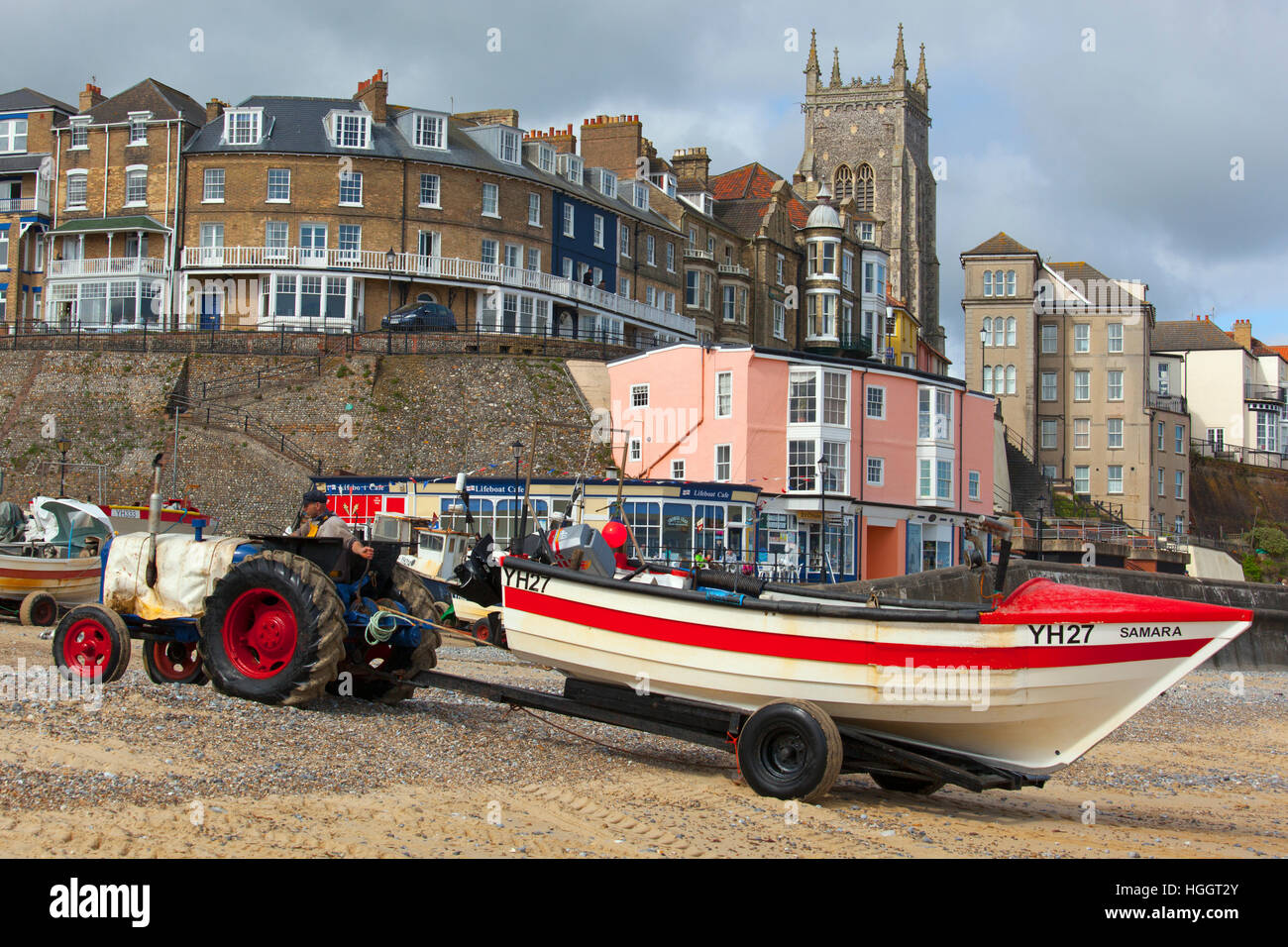 Crab boats on Cromer beach town and church in background Norfolk - Stock Image