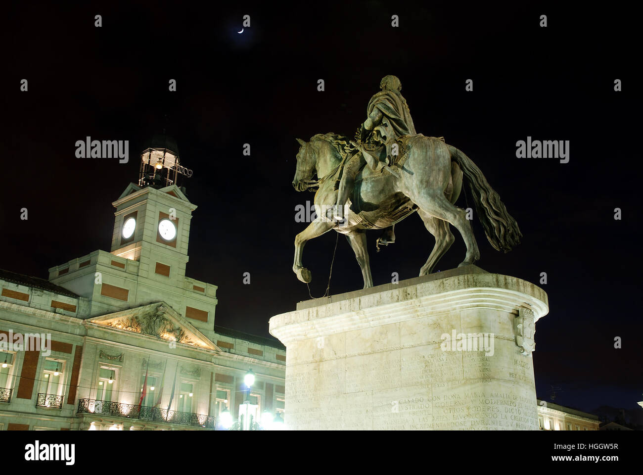 Carlos III statue and clock tower, night view. Puerta del Sol, Madrid, Spain. Stock Photo