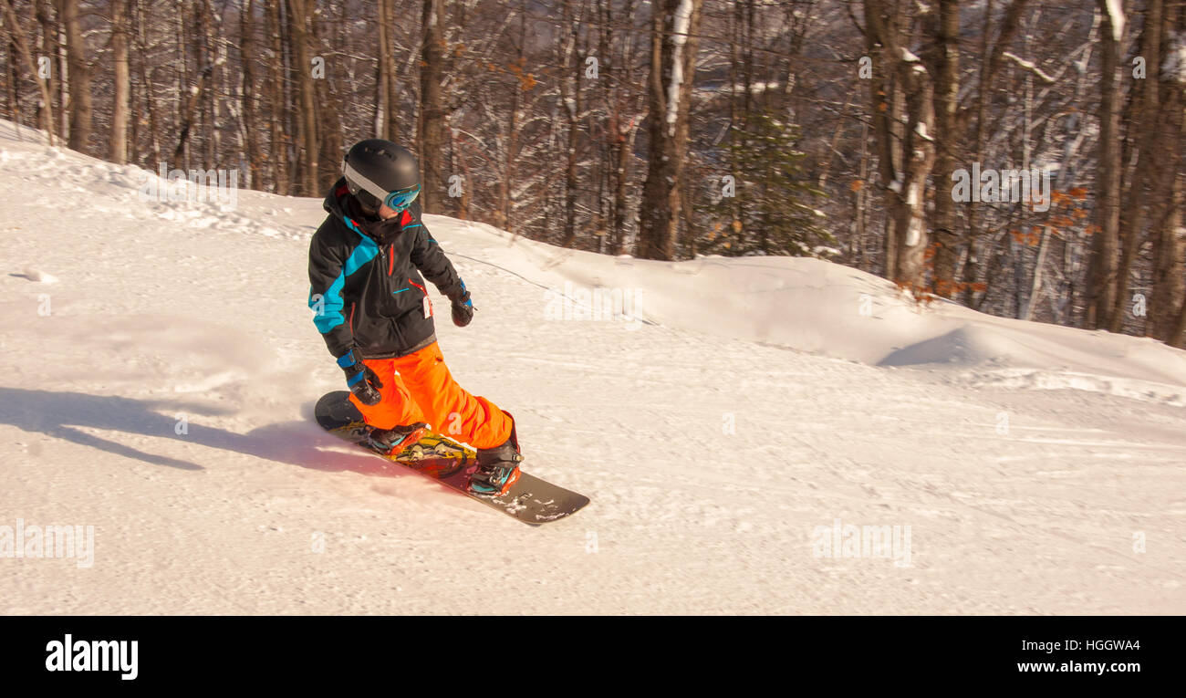 Young rider going down the mountain - Stock Image
