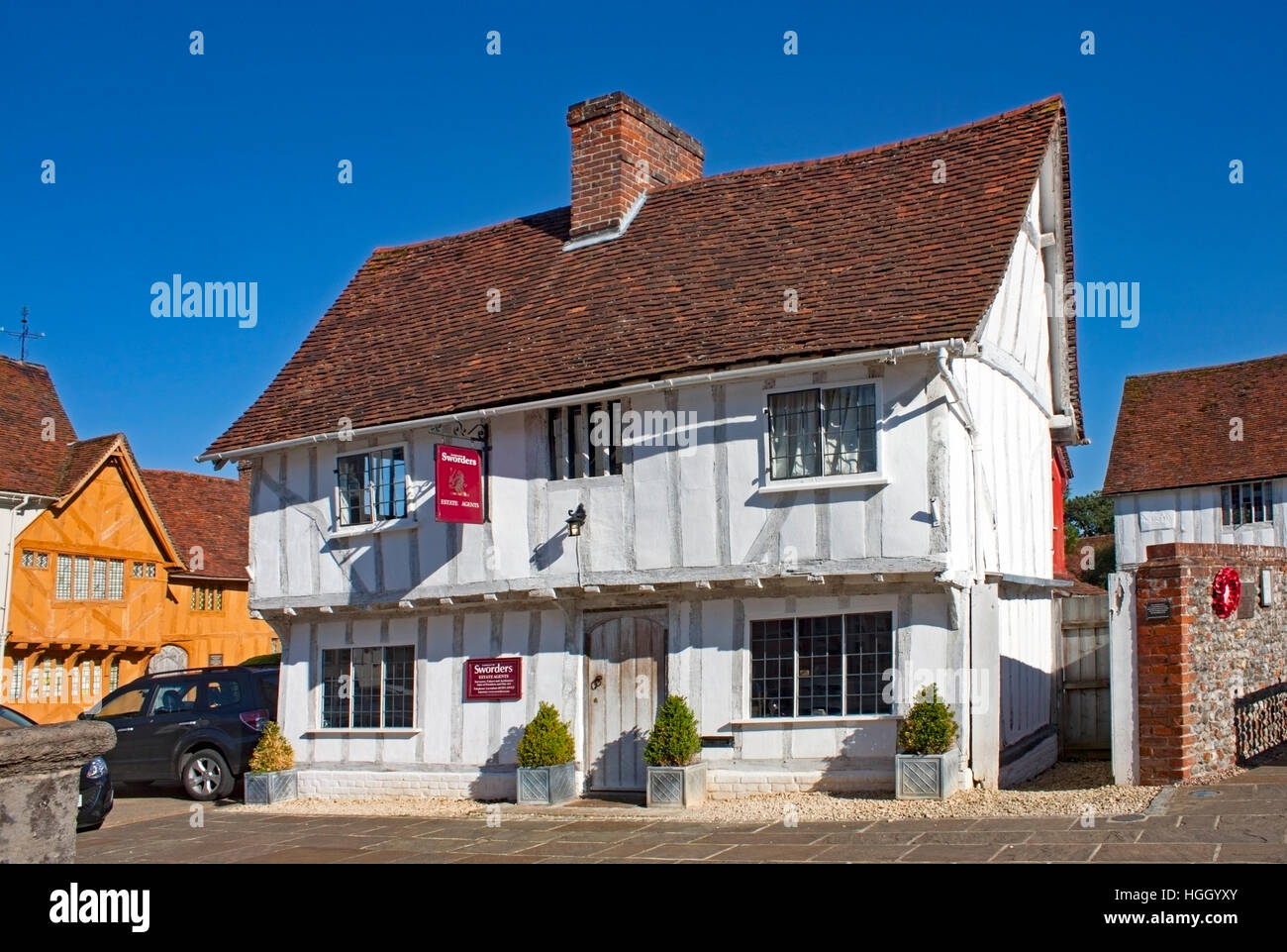 A half-timbered medieval house in the market square, now an estate agent's office. Lavenham, Suffolk ,England - Stock Image