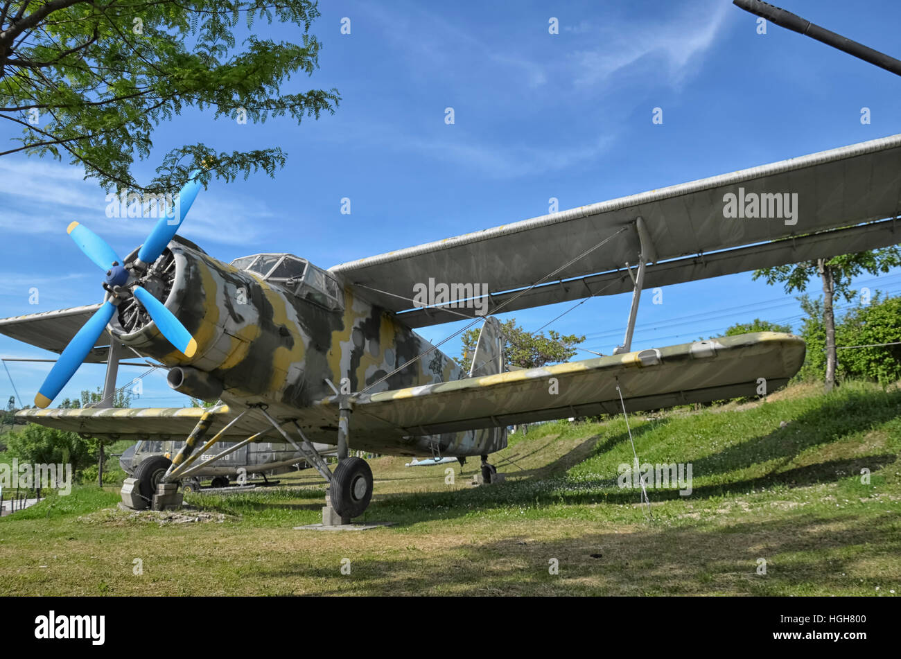 The retired Antonov An-2 military aircraft camouflaged - Stock Image