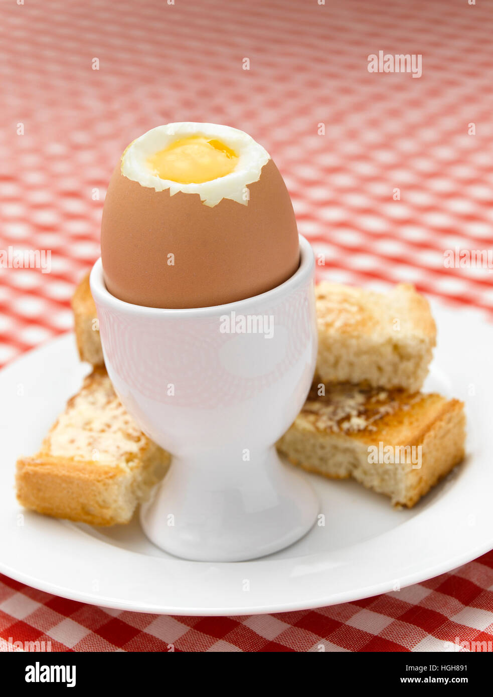 Boiled Egg on Gingham tablecloth - Stock Image