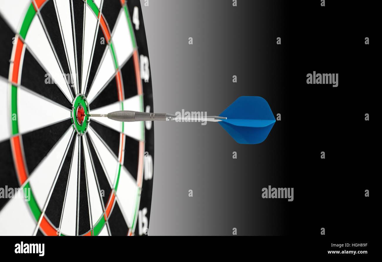 Blue Dart and dart board - Stock Image