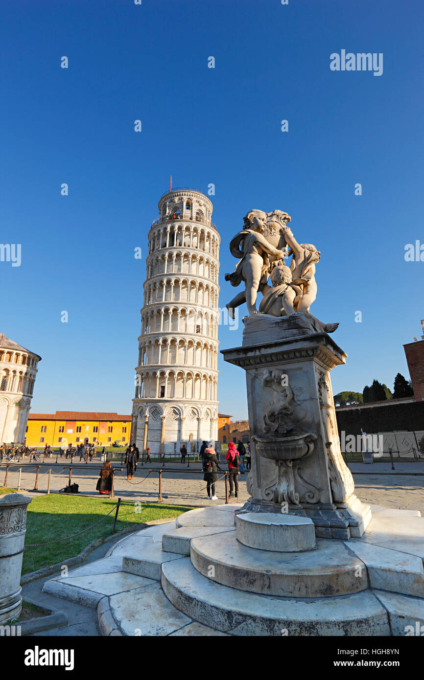 The Leaning Tower of Pisa and The Fountain with Angels on Piazza dei Miracoli in Tuscany - Stock Image