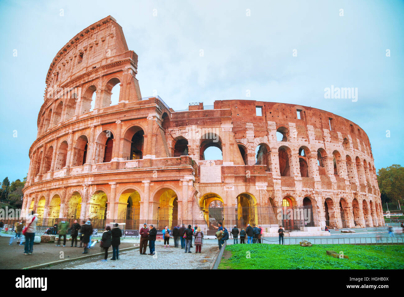ROME - NOVEMBER 08: The Colosseum or Flavian Amphitheatre with people at night on November 8, 2016 in Rome, Italy. - Stock Image