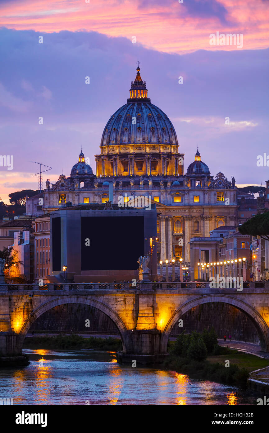 The Papal Basilica of St. Peter in the Vatican city at night Stock Photo