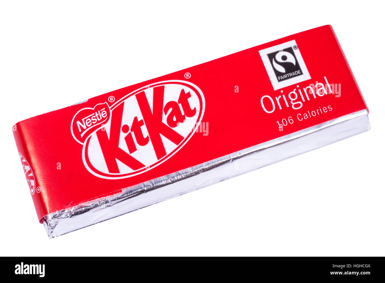 LONDON, UK - JANUARY 4TH 2017: An unopened Kit Kat chocolate bar manufactured by Nestle, pictured over a plain white - Stock Image