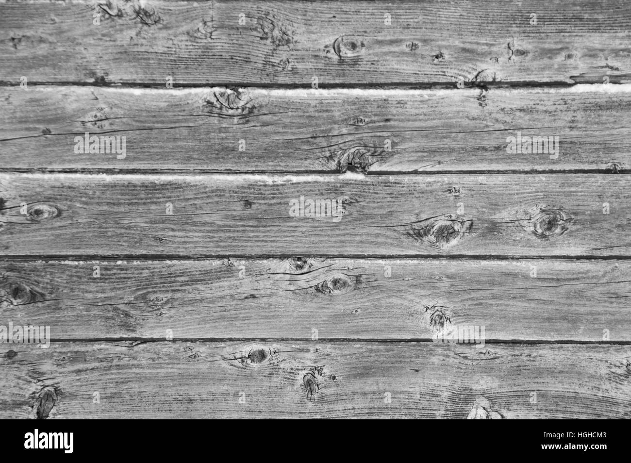 Background landscape oriented image of 5 grunge peeled silver grey weathered barn boards with remnants of paint - Stock Image