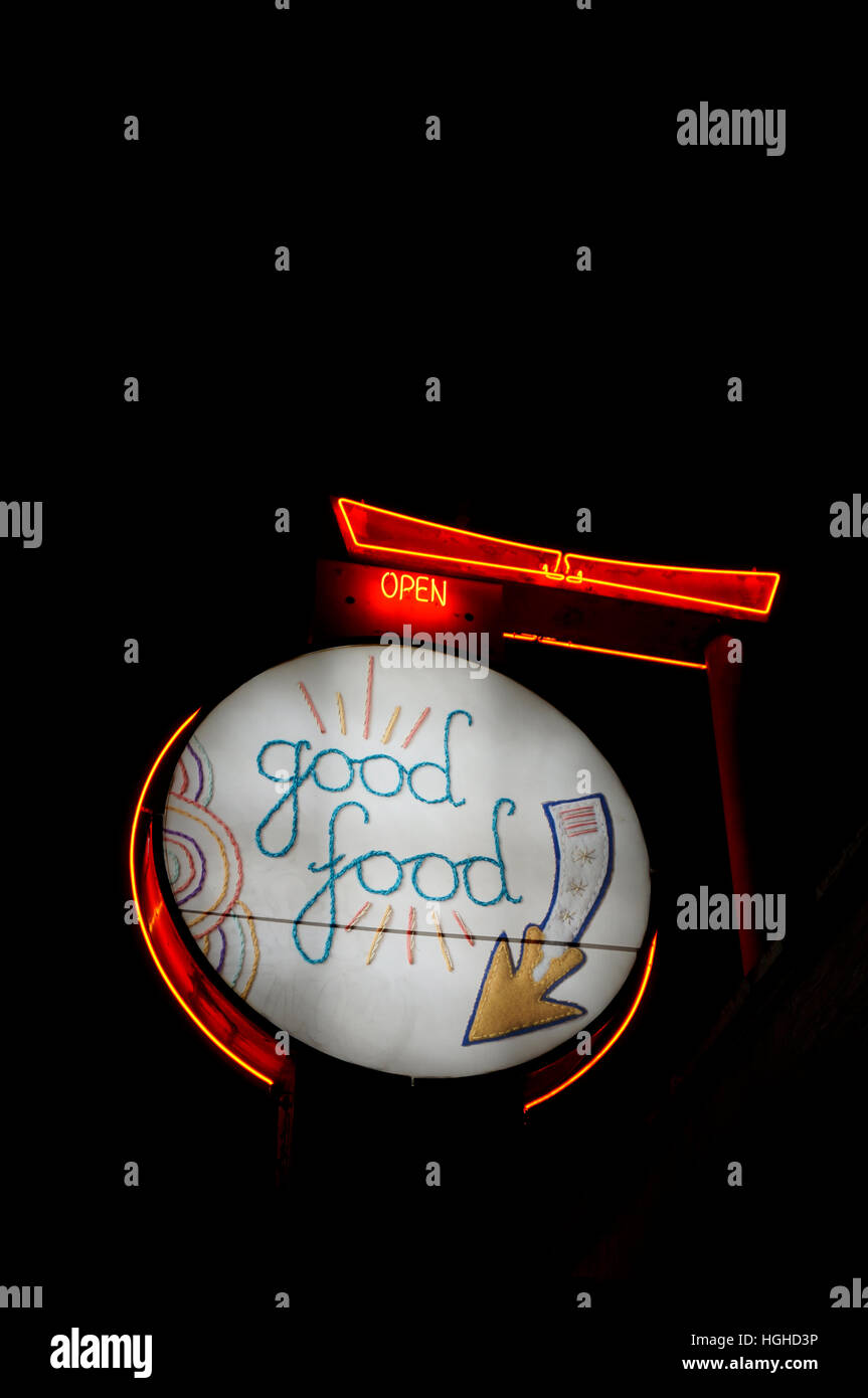 Unusual embroidered revolving sign at night outside Meet on Main vegan restaurant, Main Street, Vancouver, British - Stock Image