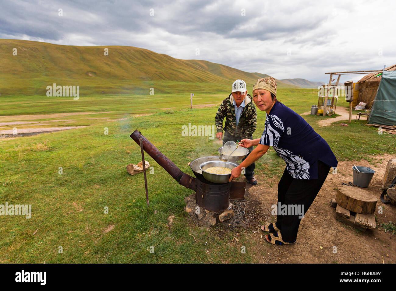 Kazakh woman making traditional noodle soup known as lagman in Assy Plateau, Kazakhstan. Stock Photo