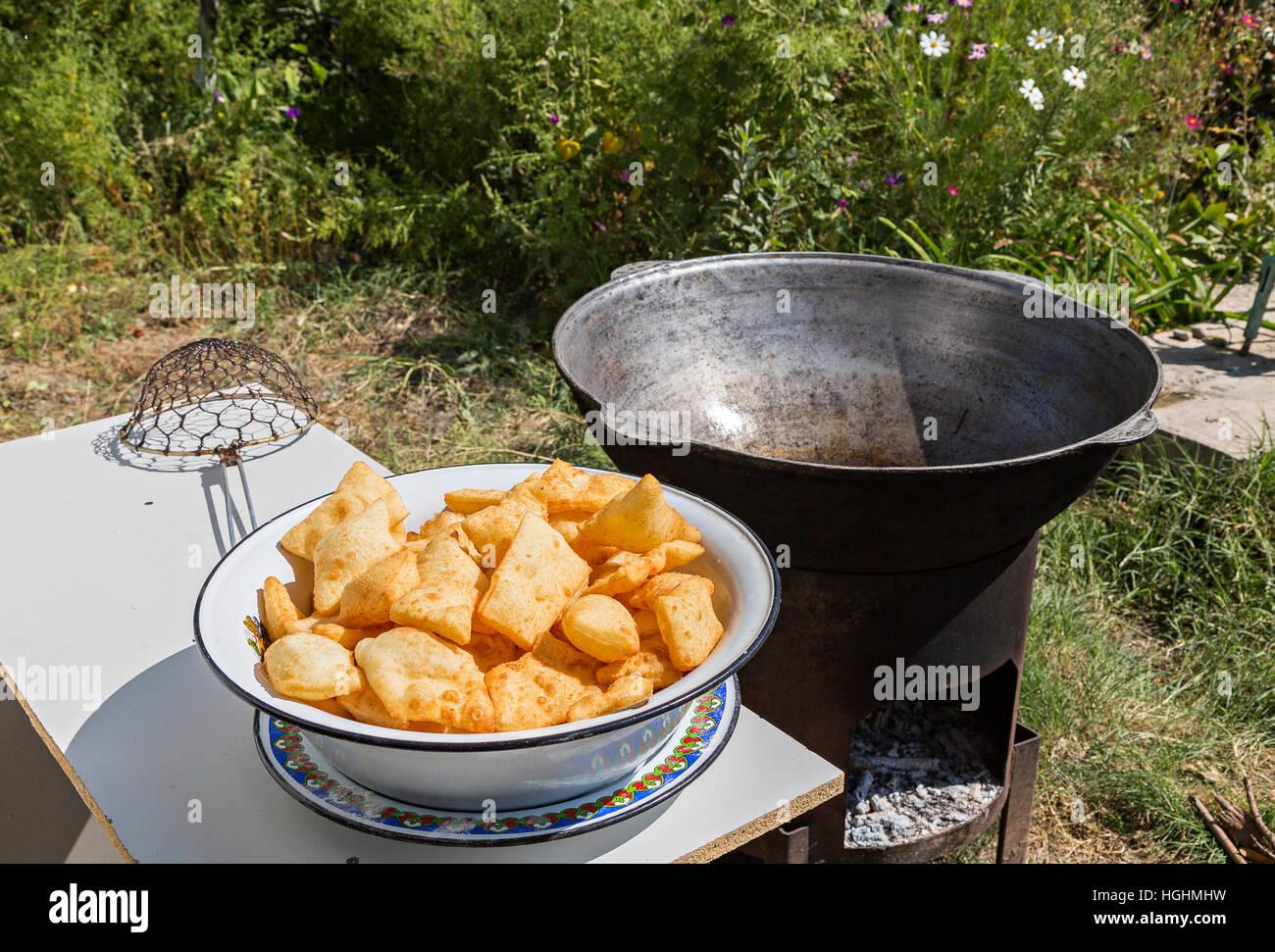 Fried puffy bread of Kazakhstan known as Baursak - Stock Image