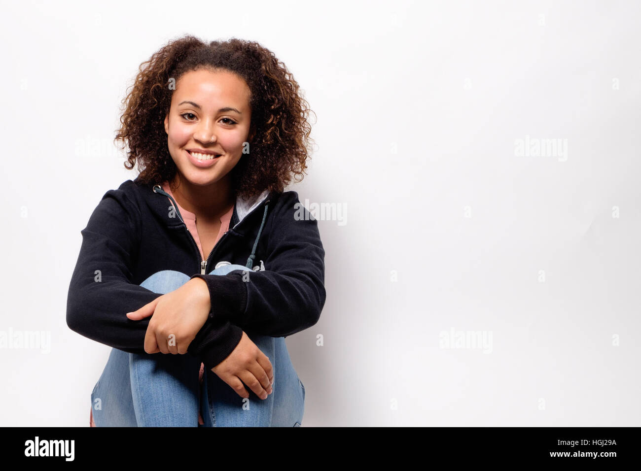 Happy afro-american woman isolated on background - Stock Image