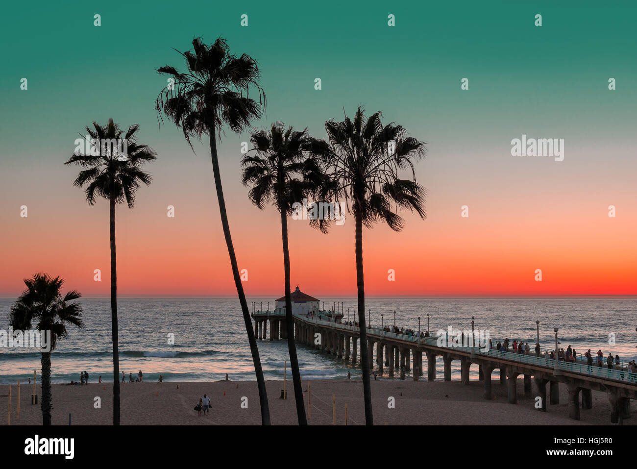 Palm trees at Sunset on Manhattan Beach. Vintage processed. - Stock Image