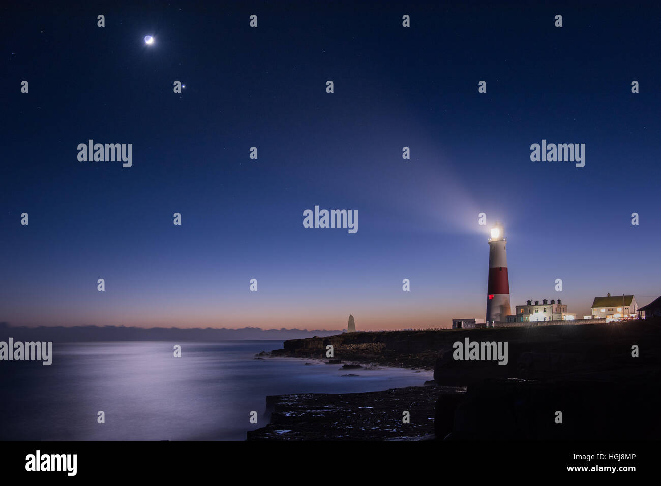 Portland Bill Lighthouse Nightscape with the Moon and planets Venus and Mars - Stock Image