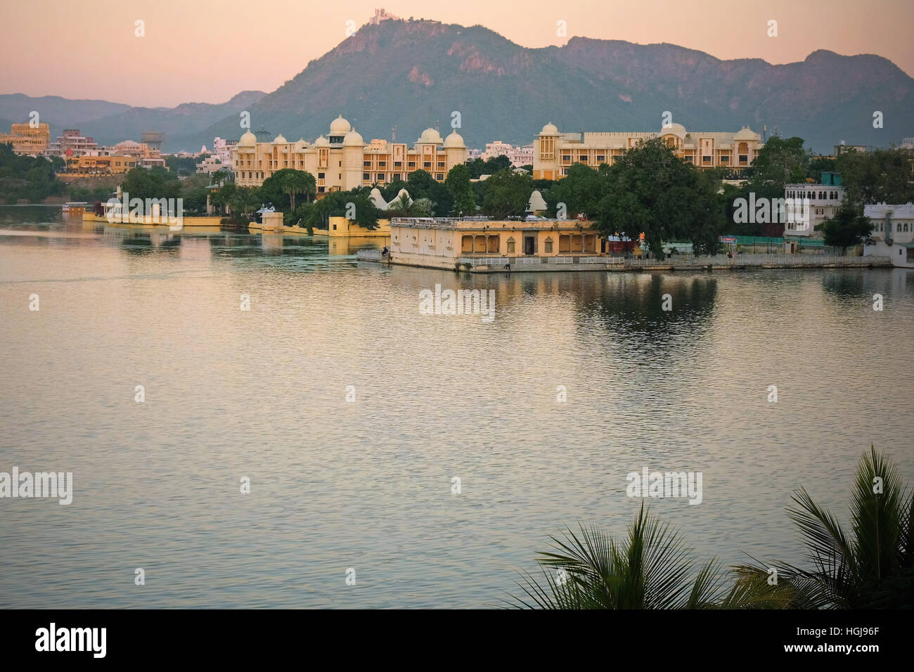 The Indian city of Udaipur at dusk in early winter. It is situated on the edge of Lake Pichola in Rajasthan - Stock Image