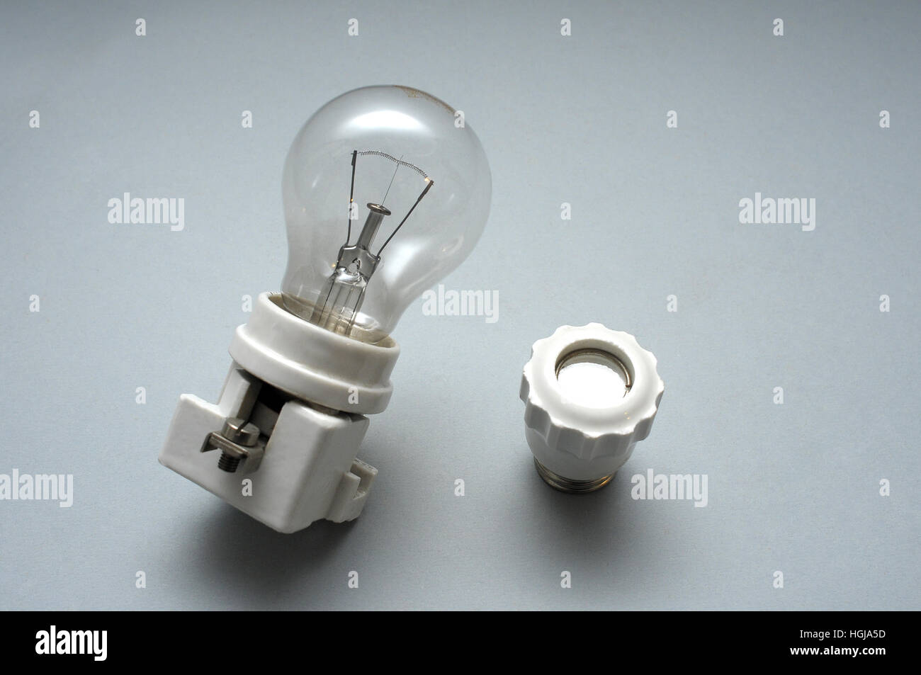 bulb,concept, concepts, dark, electricity, glow, glowing, idea, lamp, light, lighting  old,obsolete, Lampholder, - Stock Image