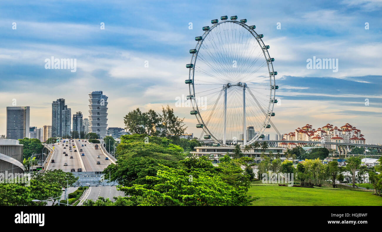 Singapore, view of the ECP (East Coast Parkway), the Marina Centre highrise, the Singapore Flyer ferris wheel and - Stock Image