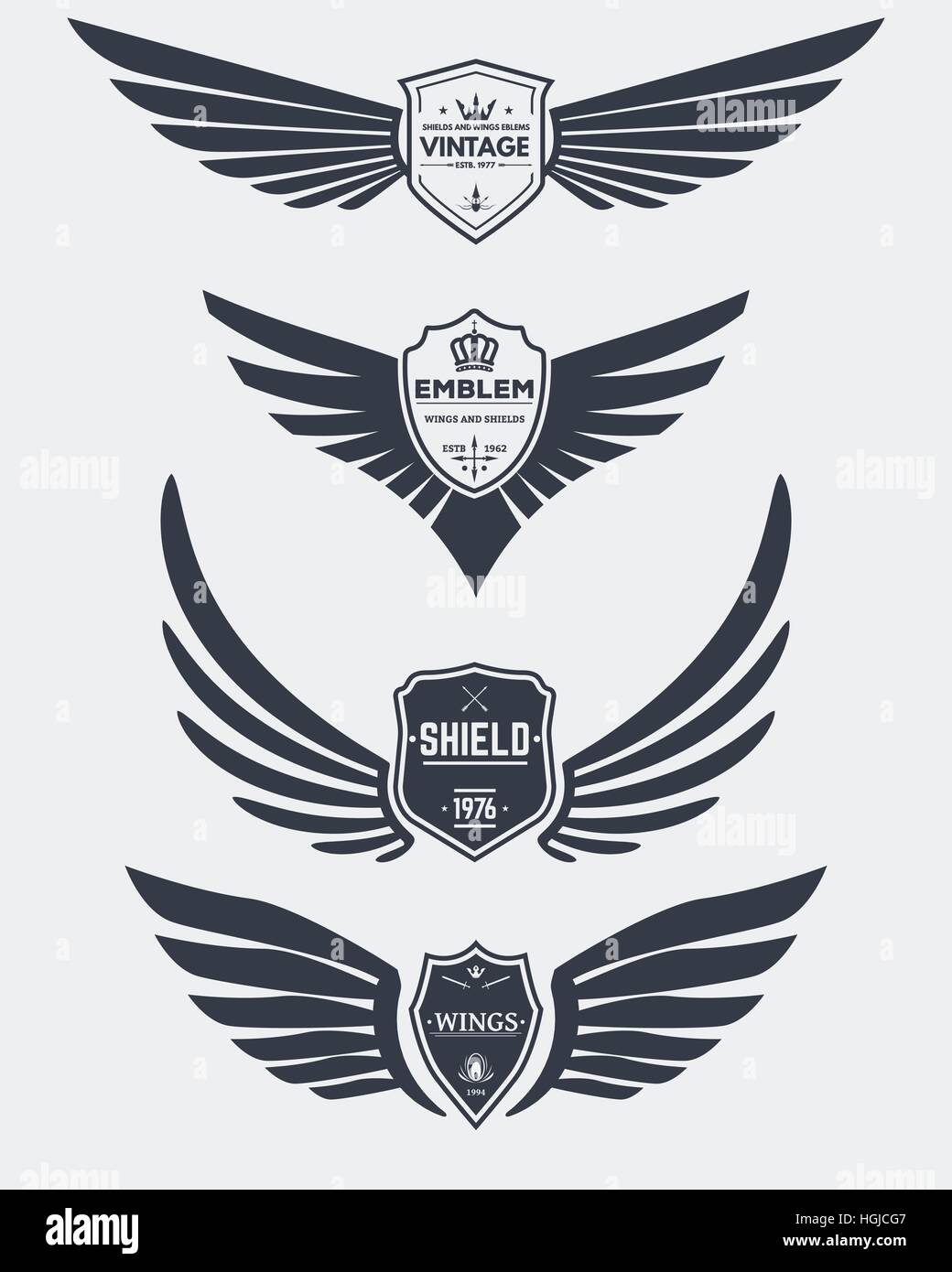 Set of inked modern wings and shields icons and emblems for logos, coat of arms signs or other graphic or printing - Stock Image