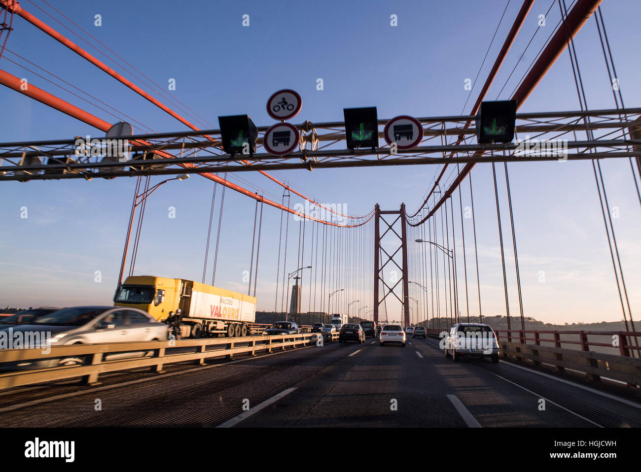 crossing the Ponte 25 de Abril bridge in Lisbon, Portugal Stock Photo