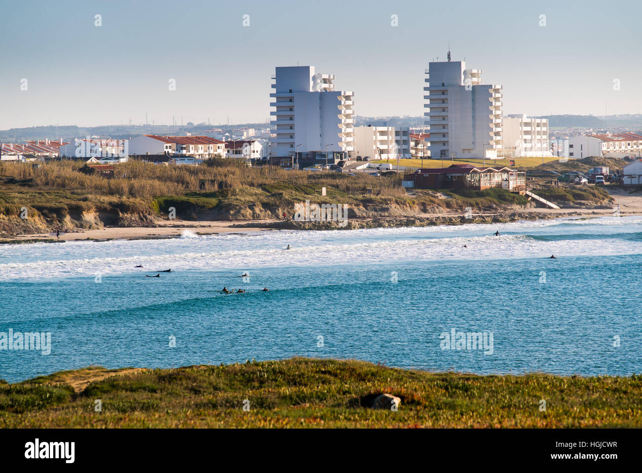 surfers make the best of the waves and sun in Peniche, Portugal - Stock Image