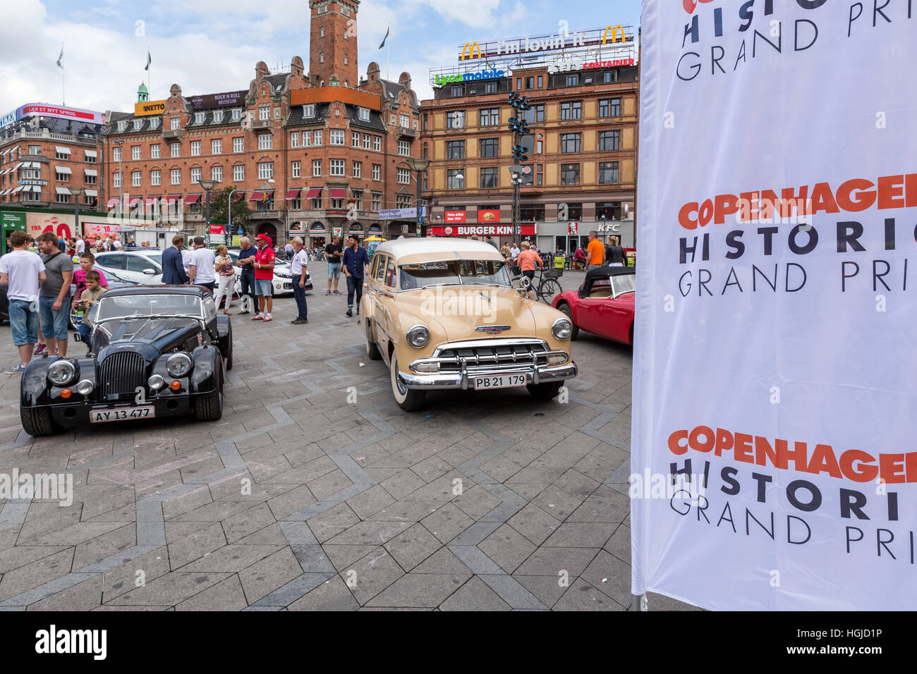 Old race cars drives in front of Copenhagen City Hall Square, Copenhagen Historic Grand Prix reception, Denmark - Stock Image