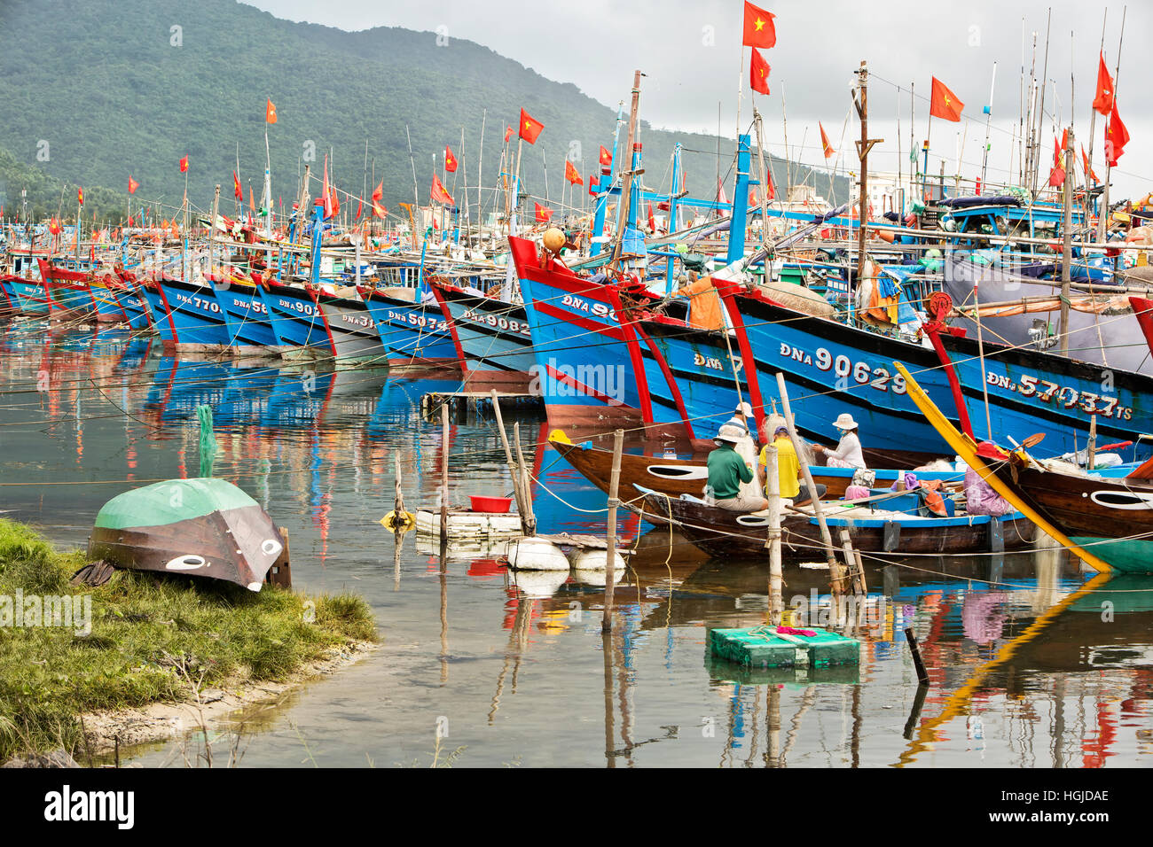 Colorful commercial fishing boats anchored in protected Da Nang harbor. Stock Photo