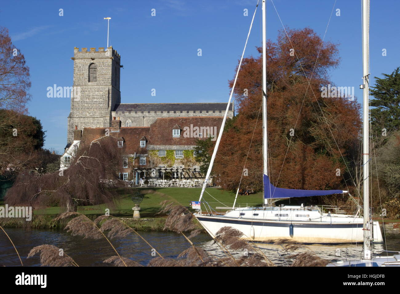 Lady St Mary Church and sail boats River Frome on a sunny Winter's day Wareham Dorset - Stock Image