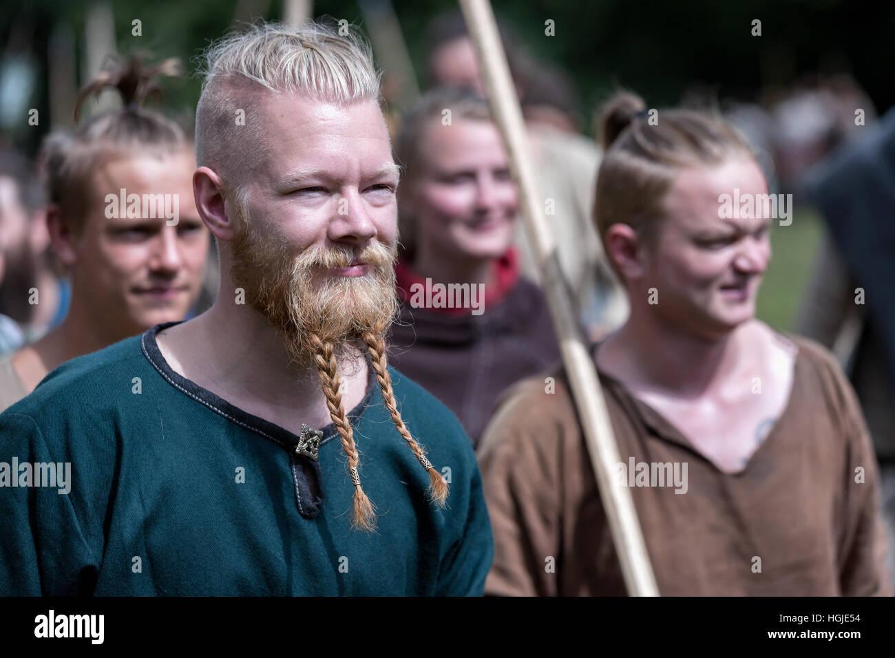 People dresses as vikings preparing for battle, Moesgaard, Aarhus, Denmark - Stock Image