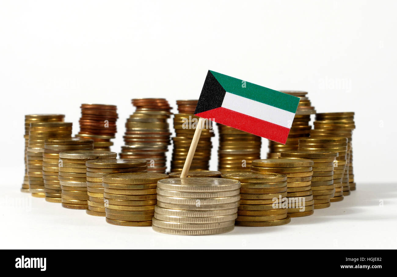 Kuwait flag waving with stack of money coins - Stock Image