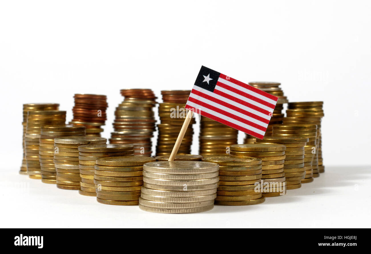 Liberia flag waving with stack of money coins - Stock Image