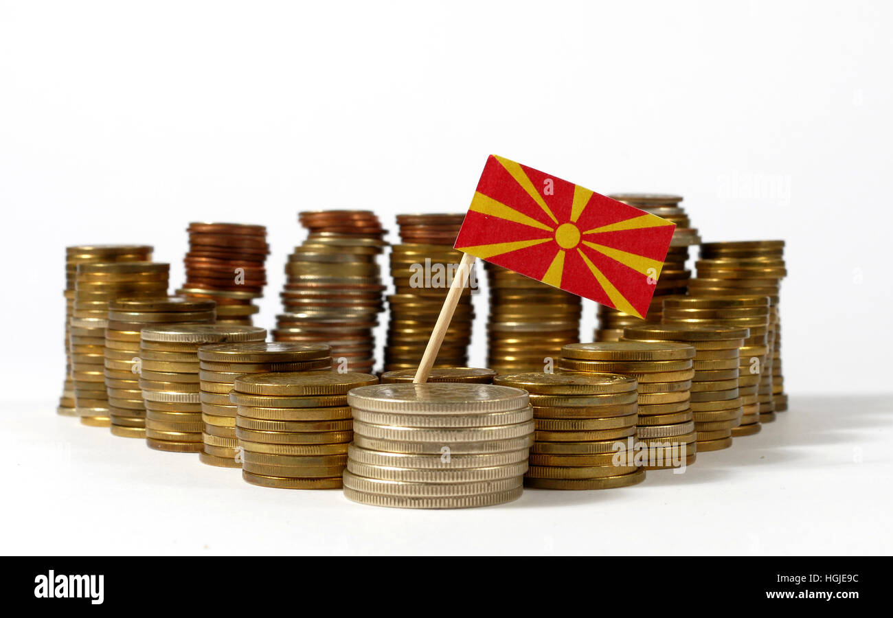Macedonia flag waving with stack of money coins - Stock Image