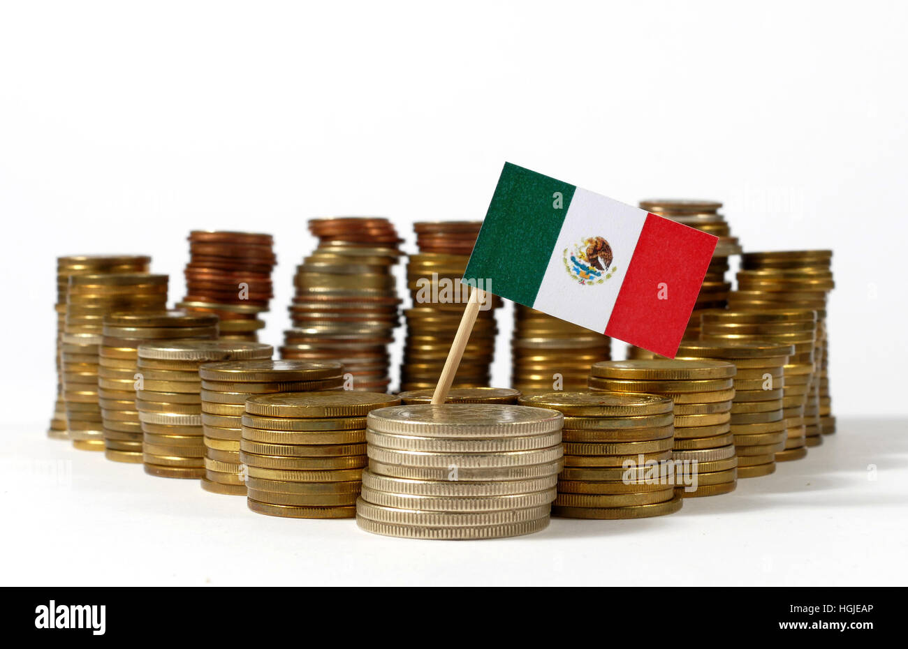 Mexico flag waving with stack of money coins - Stock Image
