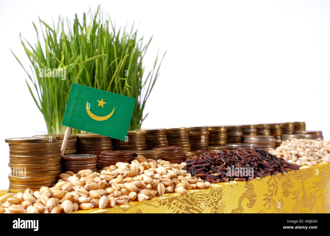 Mauritania flag waving with stack of money coins and piles of wheat and rice seeds - Stock Image