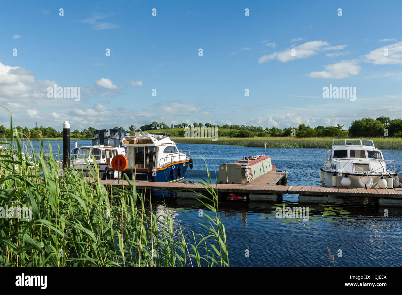 Boats moored in the marina at Carrick on Shannon, County Leitrim, Ireland on a fine day with copy space. - Stock Image