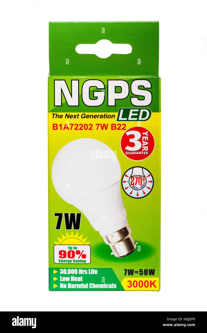 A 7 watt LED light bulb on a white background - Stock Image
