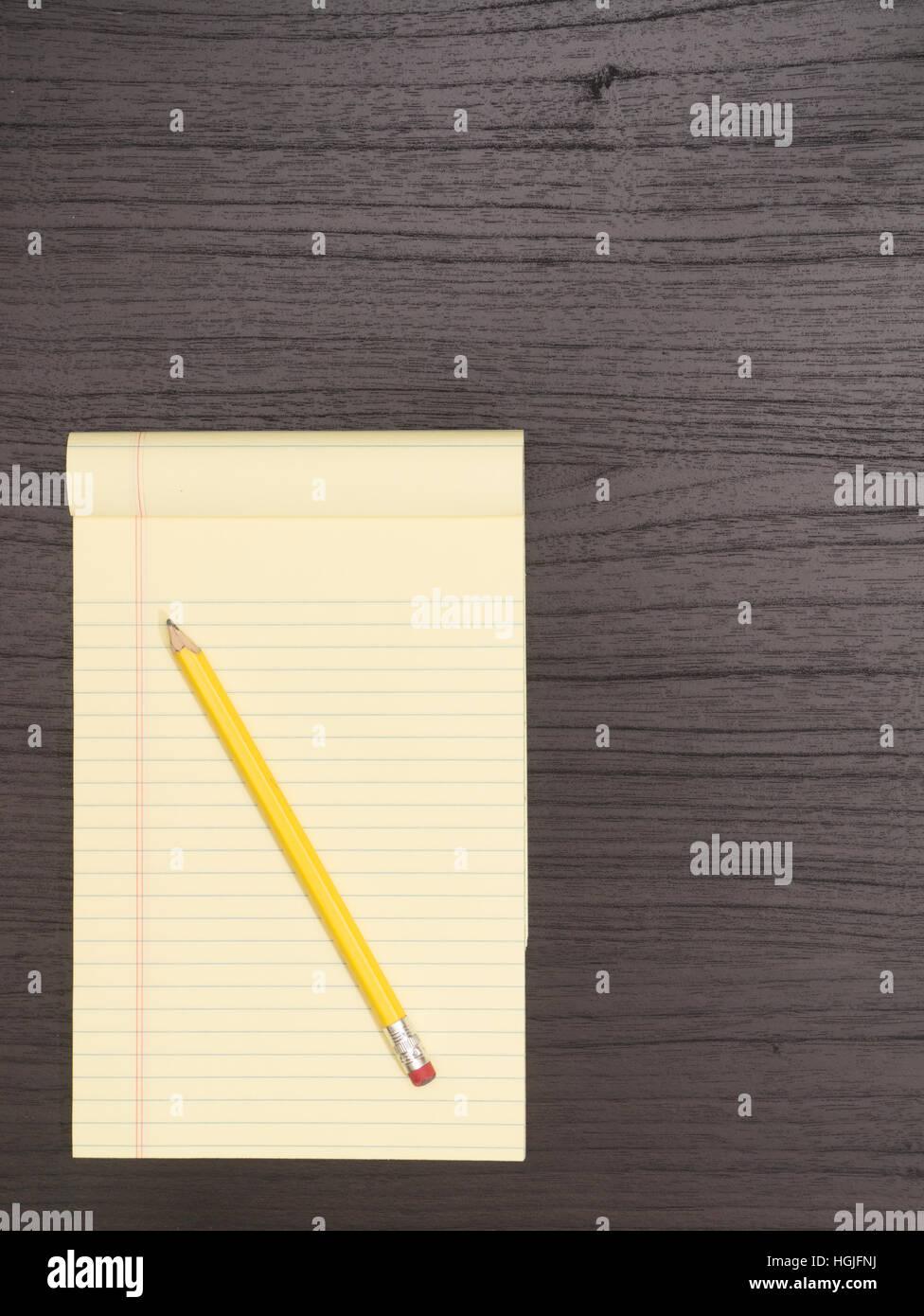 Wood Desk, Yellow Notepad, Pencil - Stock Image