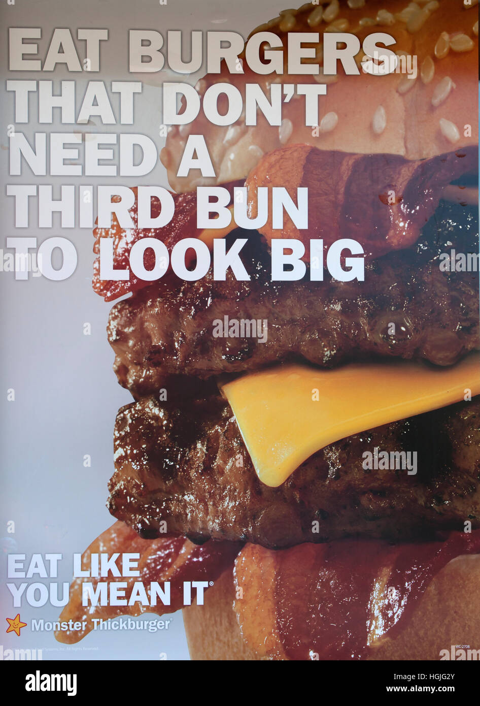 Promotional poster advertising big burgers on window of fast-food restaurant. St Paul Minnesota MN USA - Stock Image