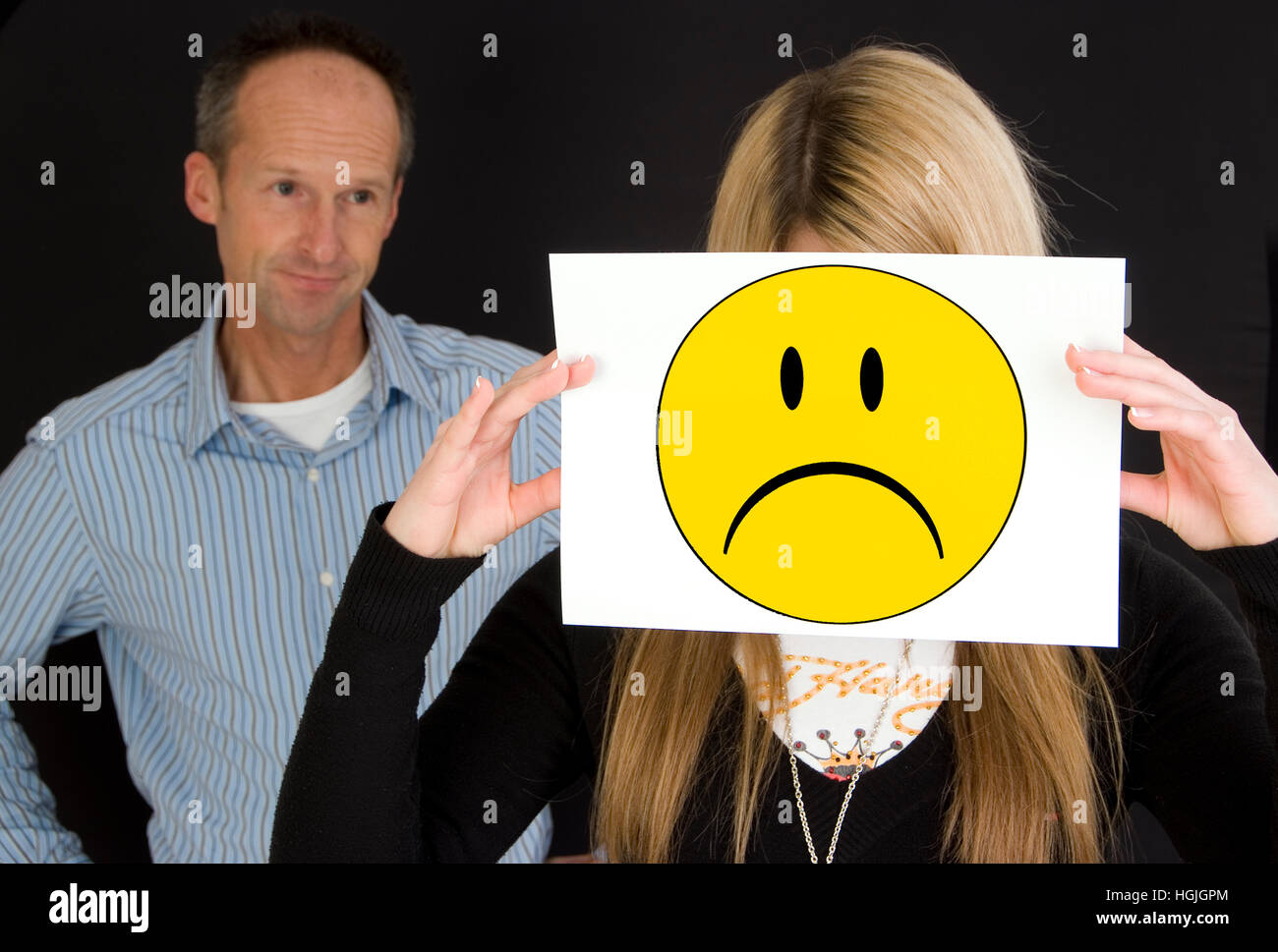 Father with sad teenager Stock Photo