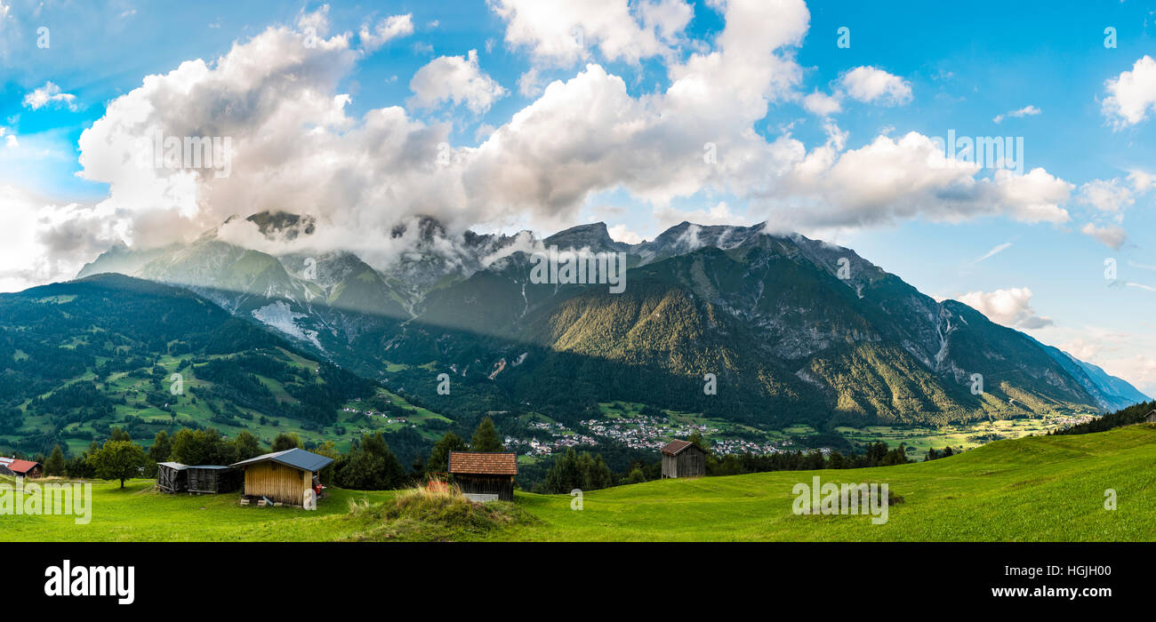Alpine panorama with clouds, Ortansicht of Grins, Dawinkopf, Parseierspitze, Simeleskopf, Mount Blankahorn, Rauher - Stock Image