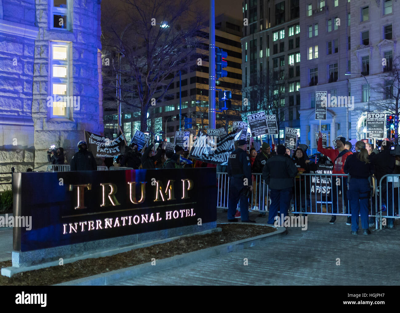 Washington, USA. 16 Jan, 2017. Protesters with 'Refuse Fascism' confront DC police and security in front of the Stock Photo