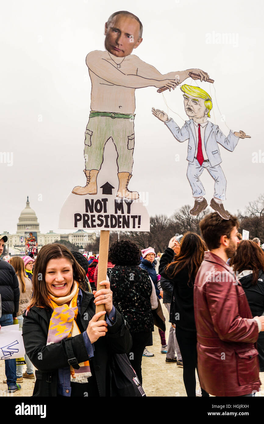 Washington, DC, USA. 21st Jan, 2017. A protestor holds an anti-Putin and anti-Trump signs during the Women's - Stock Image