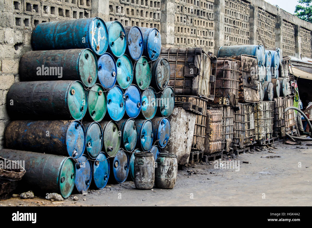 An image showing used drums and tanks piled upon one another, as captured in the city of Lagos, Nigeria - Stock Image