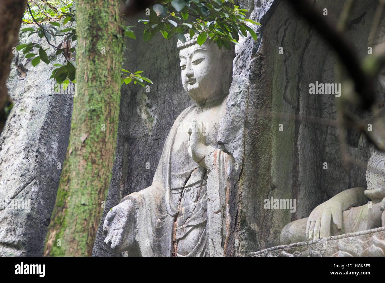 Buddha, Feilai Feng limestone grottoes at Ling Yin temple Hangzhou China - Stock Image