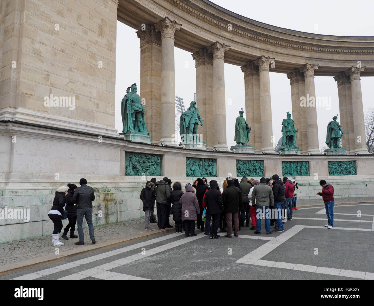 Tourists on Hosok Ter Hero square in Budapest, Hungary, one of the major tourist attractions of the city Stock Photo