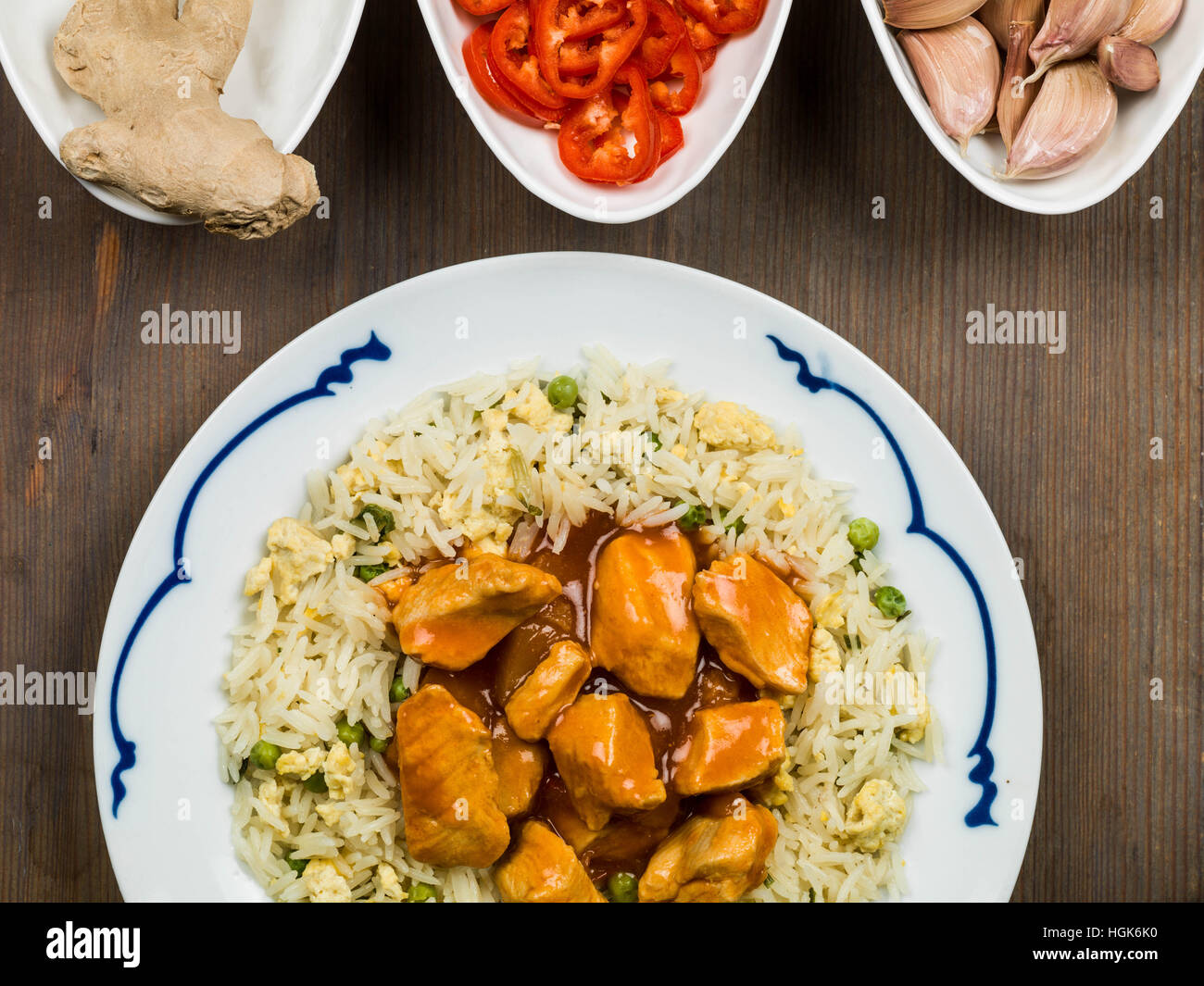 Sweet and Sour Chicken With Egg Fried Rice Chinese Meal - Stock Image