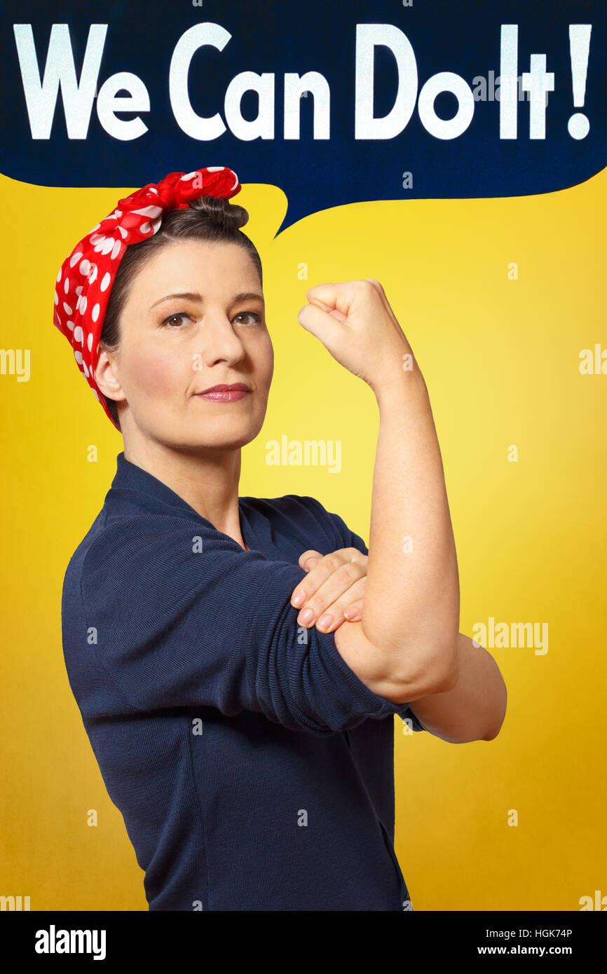 We can do it text bubble in photo of a woman with a red headscarf rolling up her sleeve, american women's lib - Stock Image