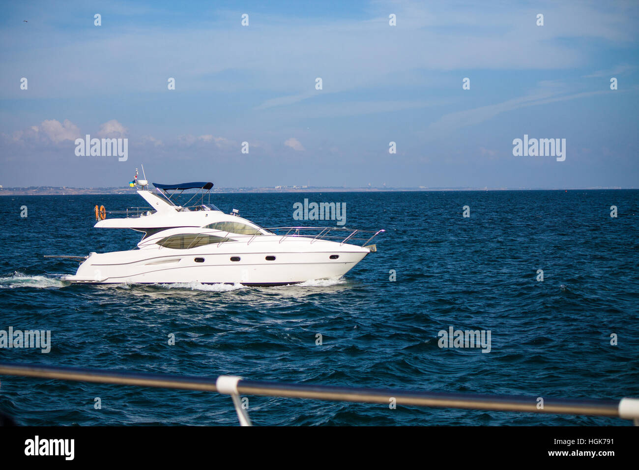 A luxury private yacht under way in the sea. - Stock Image